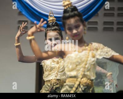 RAYONG PROVINCE, Thailand (Feb. 21, 2017) – Ban Nong Muang school students perform an ethnic Thai dance during a dedication ceremony, marking the completion of the Ban Nong Muang school expansion project. The project was a joint effort by the U.S. Naval Mobile Construction Battalion 5, Construction and Developmental Regiment, Sattahip Naval Base and Korean Naval Mobile Construction Battalion 2nd Engineer, part of Cobra Gold 2017. Cobra Gold, in its 36th iteration, is the largest Theater Security Cooperation exercise in the Indo-Asia-Pacific. This year's focus is to advance regional security an - Stock Photo