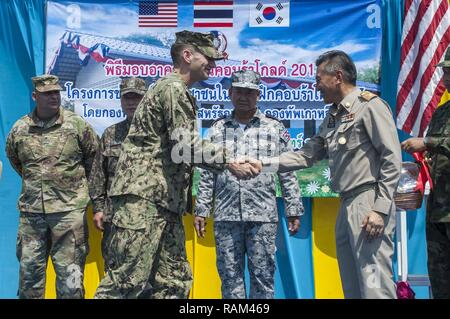 RAYONG PROVINCE, Thailand (Feb. 21, 2017) – Lt. Nicholas Peskosky, officer-in-charge of the Ban Nong Muang expansion project, assigned to Naval Mobile Construction Battalion Five, shakes hands with Gov. Surasak Charoensirichot, Rayong provincial governor during a dedication ceremony, marking the completion of the Ban Nong Muang school expansion project. The project was a joint effort by the U.S. Naval Mobile Construction Battalion 5, Construction and Developmental Regiment, Sattahip Naval Base and Korean Naval Mobile Construction Battalion 2nd Engineer, part of Cobra Gold 2017. Cobra Gold, in  - Stock Photo