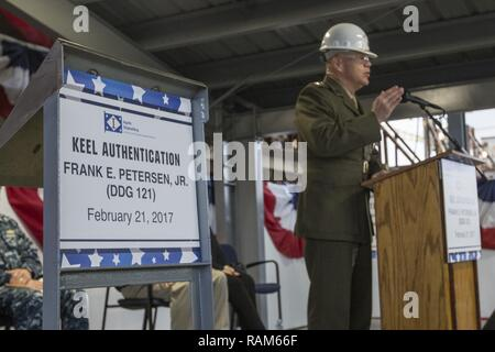 Commandant of the Marine Corps Gen. Robert B. Neller speaks to guests attending the keel laying ceremony for Frank E. Petersen, Jr. DDG 121, at Ingalls Shipbuilding, Pascagoula, Miss., Feb. 21, 2017. Neller's wife, D'Arcy, was the ship's sponsor for the ceremony. - Stock Photo