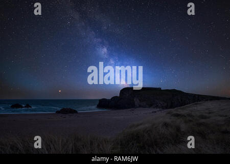 Stunning vibrant Milky Way composite image over landscape of headland and ocean - Stock Photo
