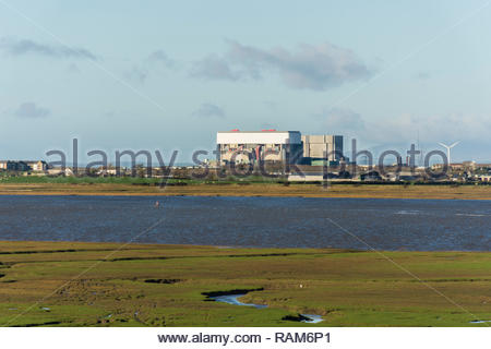 The two nuclear power stations at Heysham, Lancashire, UK, seen from across the River Lune and Lune Estuary at Glasson Dock - Stock Photo