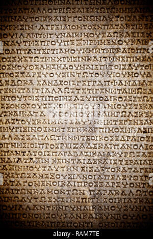 Antique Historical Ancient Greek Words on Marble Stone - Stock Photo