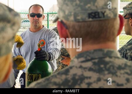 Firefighter David Guerra A Flight Medic With The Miami Dade Fire Rescue Department Mdfr Talks With Army Reserve Soldiers Assigned To The 329th Chemical Biological Radiological And Nuclear Cbrn Company Reconnaissance And Surveillance