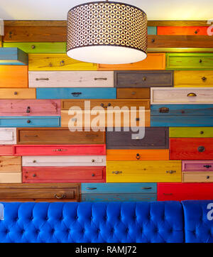 Colorful Wooden Drawer and Blue Seat Photo - Stock Photo