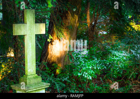 Cross Stone in Christianity Religion Cemetery and Nature - Stock Photo