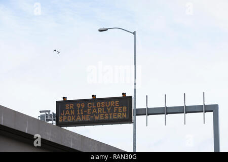 Seattle, Washington, USA. 4th January, 2019. A variable-message sign warns drivers in advance of the Alaskan Way Viaduct's permanent closure as they enter downtown. A two-mile long, bored road tunnel is replacing the Alaskan Way Viaduct, carrying State Route 99 under downtown Seattle from the SODO neighborhood to South Lake Union. The viaduct is scheduled to close permanently on January 11 so crews can move State Route 99 from the viaduct to the state-of-the-art tunnel. Credit: Paul Christian Gordon/Alamy Live News - Stock Photo