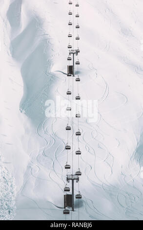 Funicular Cable cabins winter landscape minimal style snowy mountain view geometric symmetry background simple design lines and curves ski resort vaca - Stock Photo