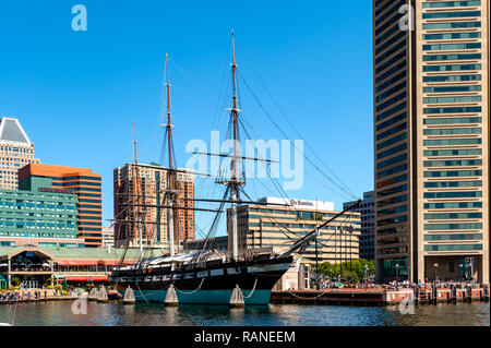 Baltimore's Inner Harbor Harborplace, World Trade Center and the 1854 USS Constellation 3 mast sloop-of-war. - Stock Photo