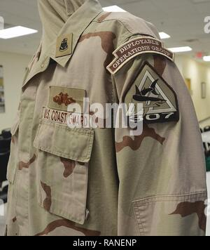 This Coast Guard Desert Combat Uniform represents a Chief Petty Officer assigned to the 307th Port Security in Clearwater, Fla. The uniform is among the hardest to find since only a few few thousand Coast Guardsmen deployed.   This unit saw deployments to Iraq and Guantanamo Bay, Cuba. - Stock Photo