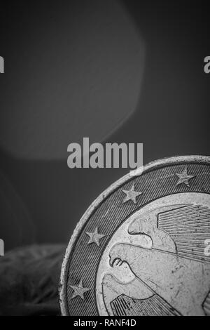 Closeup on part of a one Euro coin showing some stars and part of the eagle - Stock Photo