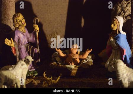 Nativity Scene in italian tradition. Nativity Scene with statues of Joseph, Mary and the little Jesus - Stock Photo