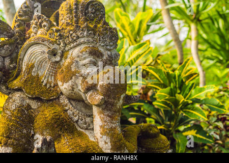 Ganesha coverd by moss in the park - Stock Photo