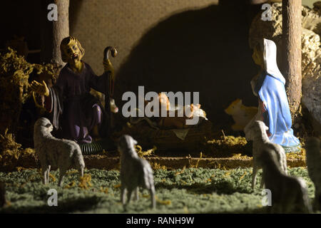 Traditional nativity scene with statues of the Holy Family. Nativity Scene with statues of Joseph, Mary and the little Jesus inside the hut. - Stock Photo