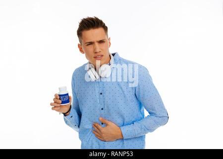 Depressed cheerless man having problems with sleep - Stock Photo