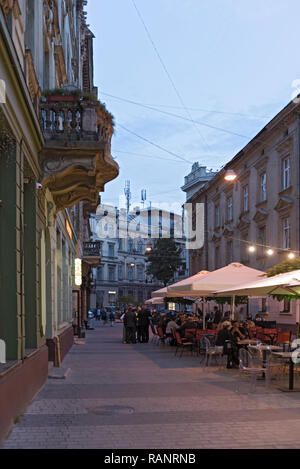 Street with passers-by in the old town of, Lviv, Ukraine - Stock Photo