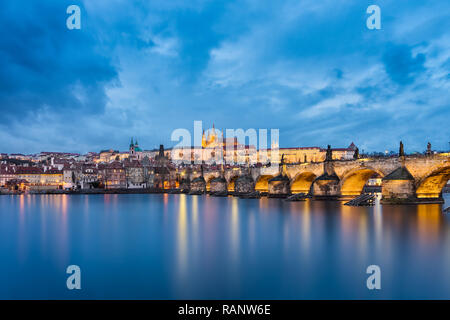 Castle and Charles Bridge at night in Prague, Czech Republic - Stock Photo