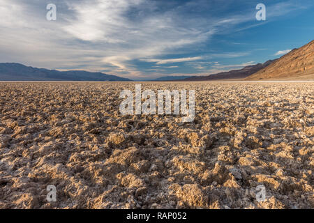 Clumps of Salt and Mud Creating a Forbidding Landscape, Badwater Basin, Death Valley National Park - Stock Photo