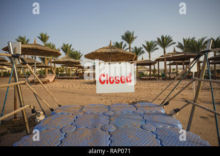 Closed passage to swimming area on summer tropical beach. Horizontal color photography. - Stock Photo