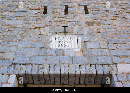Text 'Erbaut im jahre' ( Built in the year) 1836 on the  medieval castle of the town of Budva, dedicated to Santa Maria, better known as Citadela, loc - Stock Photo
