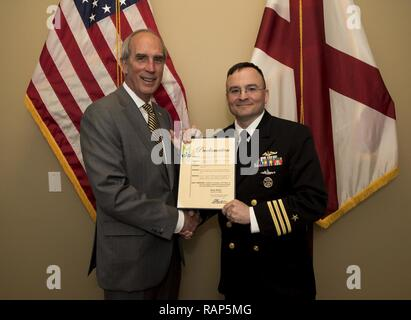 MOBILE, Ala. – (Feb. 23, 2017) Mobile Mayor Sandy Stimpson presents Cmdr. Paul Reinhardt, commanding officer of USS Alabama (SSBN 731), with a proclamation designating the Feb. 22 through Feb. 28 as Navy Week in the City of Mobile. Navy Week program serves as the Navy's principal outreach effort in areas of the country without a significant Navy presence. - Stock Photo
