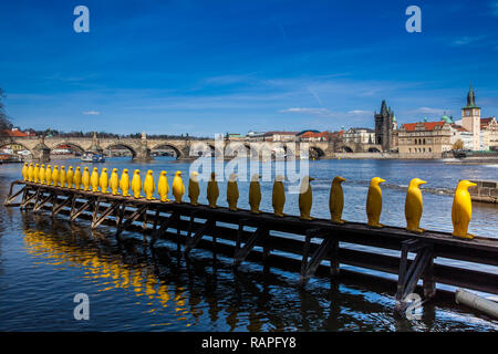 Yellow Penguins at Kampa park created by the Cracking Art Group with recycled bottles - Stock Photo
