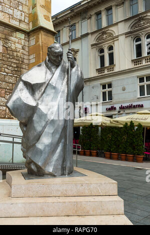 Statue of Pope John Paul II in front of the Christian Sacred Heart Cathedral, Sarajevo old town, Bosnia and Herzegovina - Stock Photo