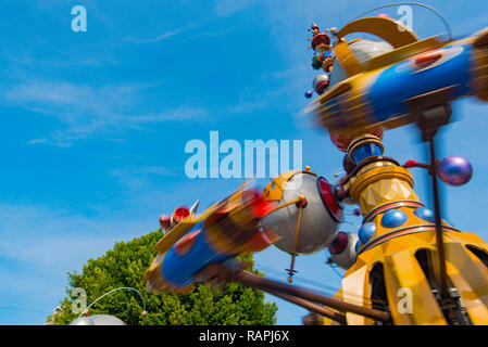 The Orbitron a Rocket-Spinner Ride In action at Disneyland Anaheim, LA, California USA - Stock Photo