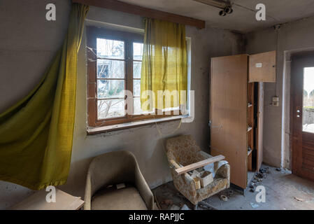 Prerow, Germany - December 30, 2018: View of the remains of an office in the former training centre of the GDR Society for Sport and Technology (GST)  - Stock Photo