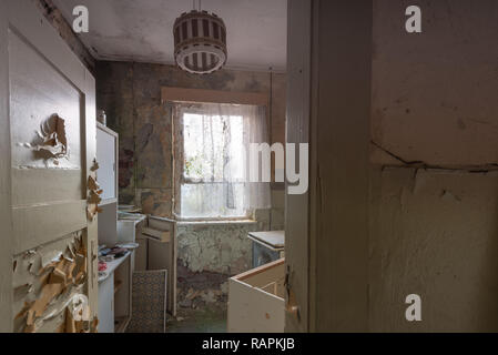 Prerow, Germany - December 30, 2018: View into the kitchen of one of the barracks of the former training centre of the Gesellschaft für Sport und Tech - Stock Photo