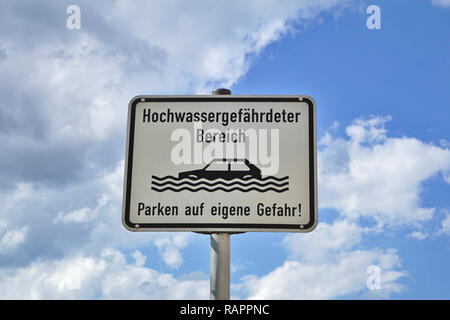 Sign: flood-prone area. Parking at your own risk! - Stock Photo