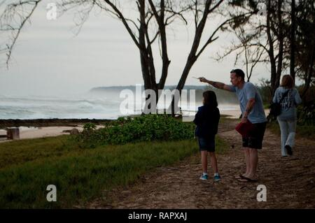 HALEIWA, Hawaii — Sgt. 1st Class Paul D'Veney, a production control noncommissioned officer in charge with Company B, 209th Aviation Support Battalion, 25th Combat Aviation Brigade, and his daughter Cali, participate in the 2017 Sanctuary Ocean Count Project at Pua'ena Point, Feb. 25, 2017. Pua'ena Point is one of the sites where volunteers track humpback whale sightings. The Sanctuary Ocean Count occurs during January, February and March of each year, and is coordinated by the Hawaiian Islands Humpback Whale National Marine Sanctuary. Residents and non-residents may participate in the count a - Stock Photo