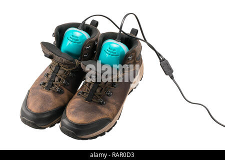 Men's leather boots with shoes dryer isolated over white - Stock Photo