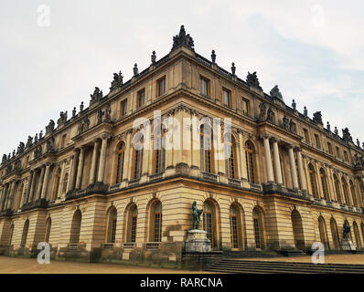 Outdoors Versailles Palace facade view from the corner. Royal chateau, world heritage site. - Stock Photo