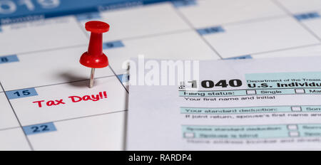 Printed copy of simplified Form 1040 for income tax return for 2018 with reminder for April 15, 2019 deadline - Stock Photo