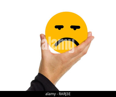Hand holding a yellow circle with face expression sad illustration. - Stock Photo
