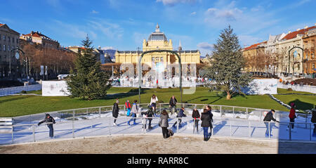 ZAGREB, CROATIA - JANUARY 04, 2019: Young people skating on the city ice skating rink on Advent time in King Tomislav Park on January 04, 2019 in Zagr - Stock Photo