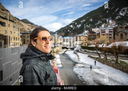 Young woman admiring the beauty of Andorra in winter - Stock Photo