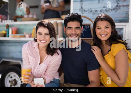 Portrait of happy friends smiling - Stock Photo