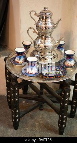traditional turkish tea silverware utensil set on small vintage coffee table - Stock Photo