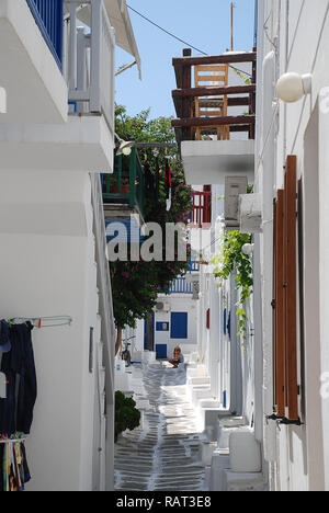 Typical houses in a narrow street on Mykonos island, Greece. - Stock Photo