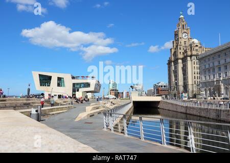 LIVERPOOL, UK - APRIL 20: People visit Pier Head area on April 20, 2013 in Liverpool, UK. Pier Head is part of Liverpool's famous UNESCO World Heritag - Stock Photo