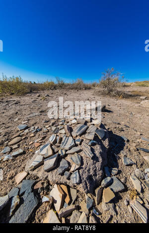 Potsherds placed reverently by hikers at the Tsankawi Prehistoric Sites in Bandelier National Monument near Los Alamos, New Mexico - Stock Photo
