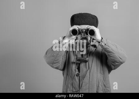 Conception - soldier on the post. Observation with binoculars, uniforms of the Great Patriotic War, monochrome effect - Stock Photo