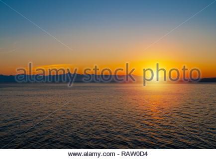 Sun goes down behind mountains. Avacha Bay. - Stock Photo