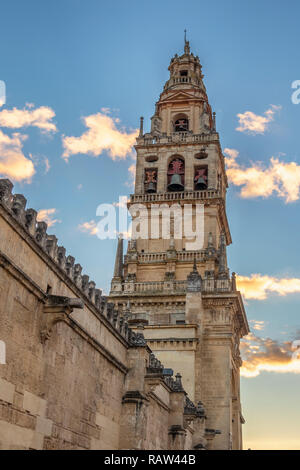 Bell tower of mosque-cathedral of Cordoba at sunset. Original Muslim minaret this structure has played an important role in the image and profile of C - Stock Photo