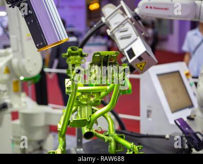Bangkok, Thailand - November 23, 2018: Kawasaki robot arm vision inspect assembly part display in Metalex 2018 - Stock Photo