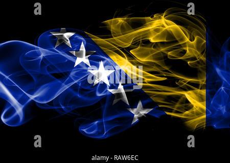National flag of Bosnia and Herzegovina made from colored smoke isolated on black background - Stock Photo
