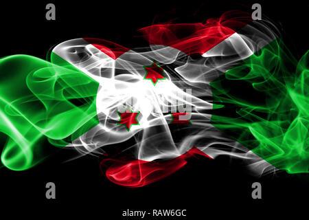 National flag of Burundi made from colored smoke isolated on black background - Stock Photo