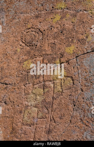 Petroglyph of stylized human figure carved into sandstone by Ancestral Puebloan People at the Tsankawi Prehistoric Sites in Bandelier National Monumen - Stock Photo