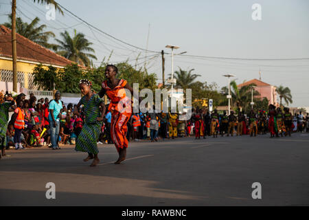 Bissau, Republic of Guinea-Bissau - February 12, 2018: Two young girls wearing traditional dresses during the Carnival Celebrations in the city of Bis - Stock Photo